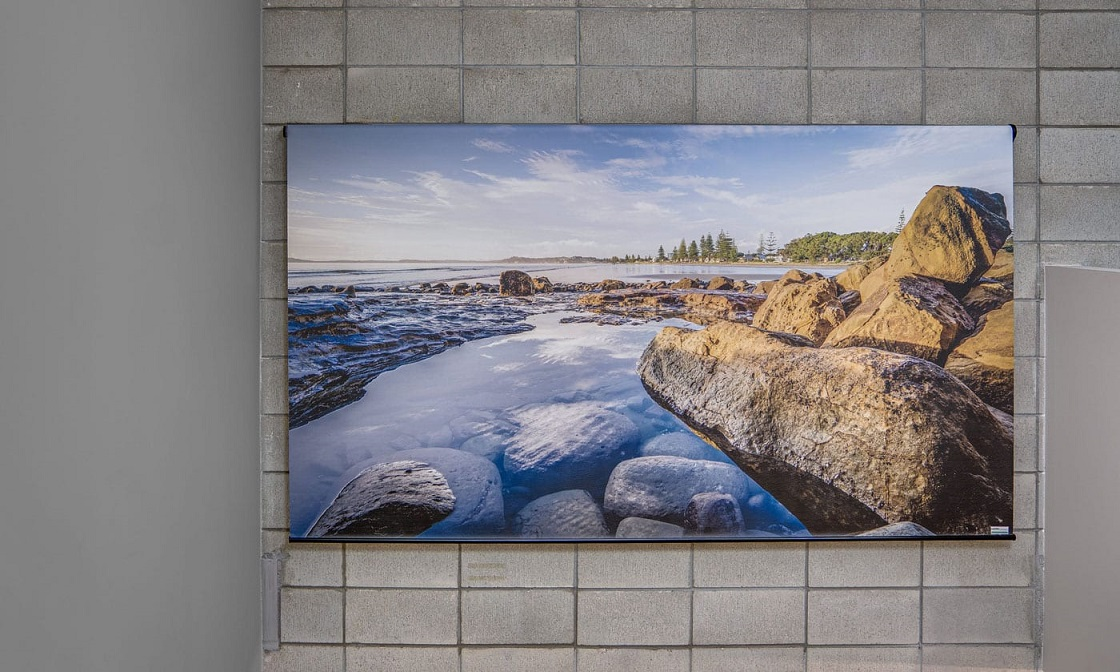 An image of a printed roller blind, featuring a grey riverhead stones photograph from NZ Blinds collection