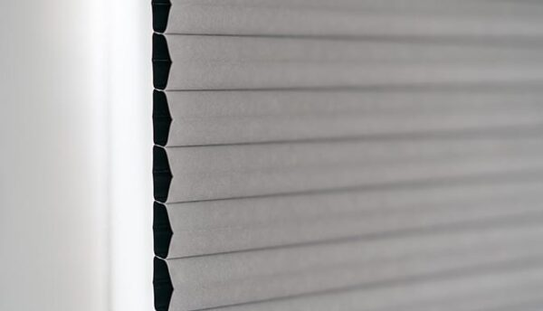 Close up on grey honeycomb blinds