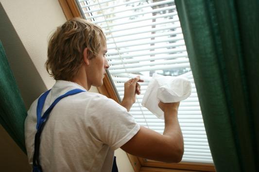 stock photo model cleaning aluminium venetian blinds