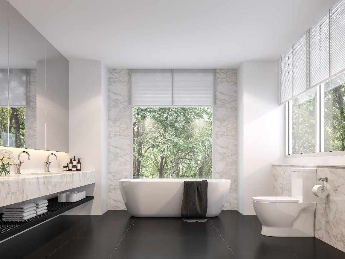 Luxurious bathroom with natural views, black tile floors, white marble walls, and light venetian window blinds