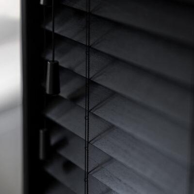 Close up on black wooden venetian blinds