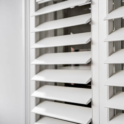 Close up on white shutters