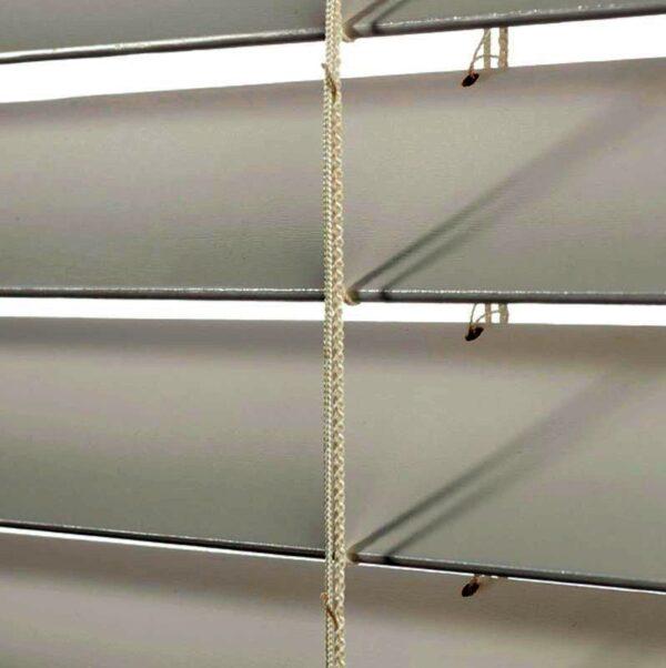 A close-up of Norman faux wood venetian blind slats.
