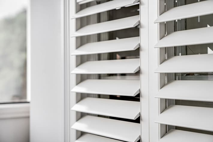 White interior plantation shutters and window blinds.