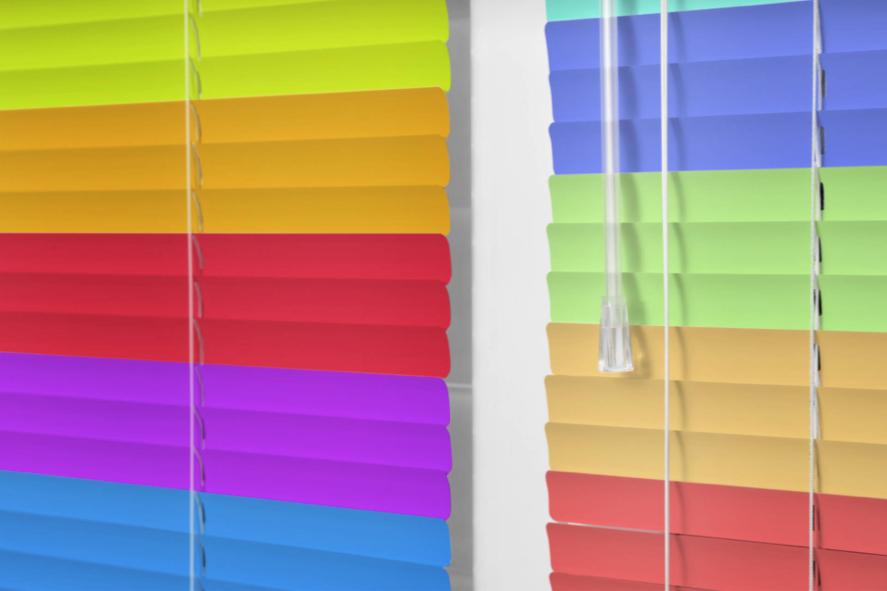 Vibrant, rainbow-coloured Venetian blinds