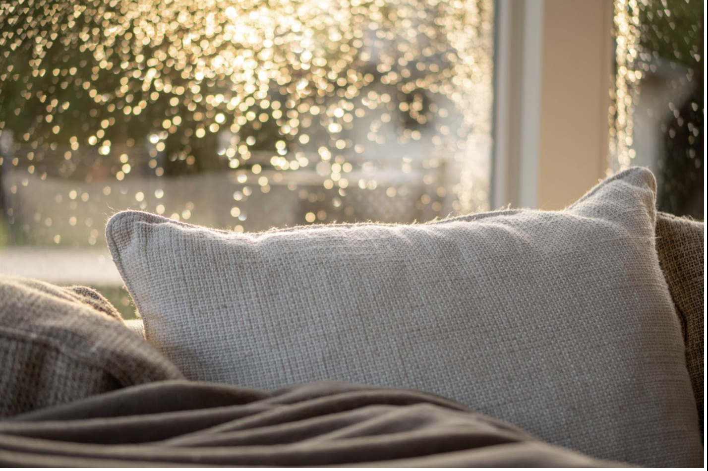 Cosy pillow next to window overlooking chilly exterior